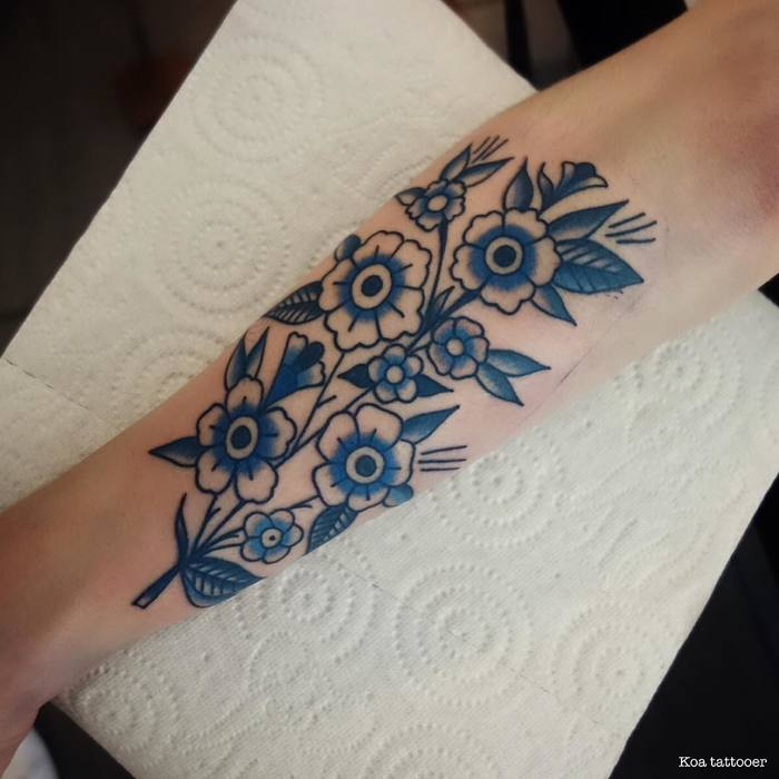 Blue Ink Flower Tattoo by Koa Tattoo