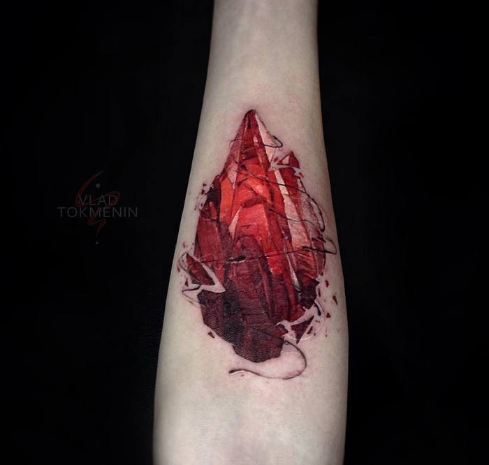 Gem tattoo on the inner forearm by Vlad Tokmenin