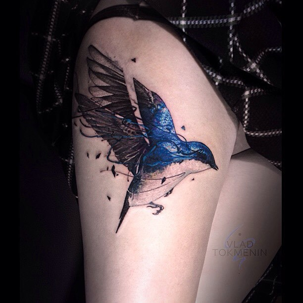 Tree swallow tattoo on the right thigh by Vlad Tokmenin