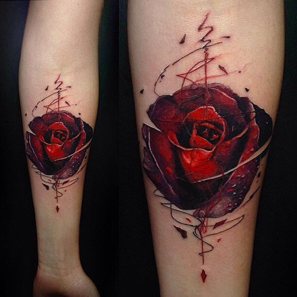 Graphic style red rose tattoo on the inner forearm by Vlad Tokmenin