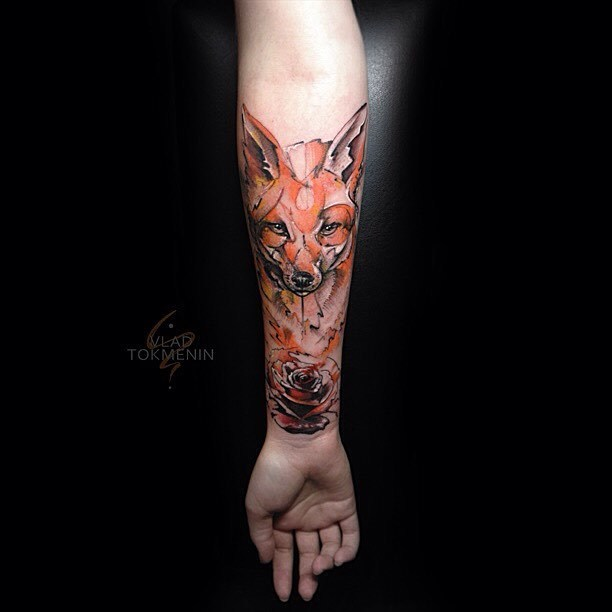 Sketch work style fox and rose tattoo on the right inner forearm by Vlad Tokmenin