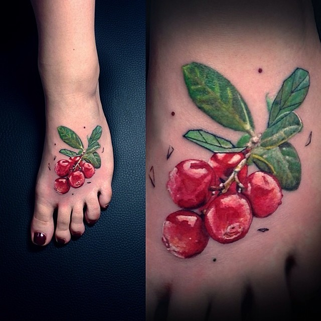 Realistic cranberry tattoo on the left foot by Vlad Tokmenin
