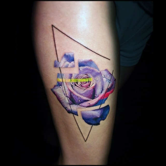 Graphic purple rose tattoo on the calf by Vlad Tokmenin