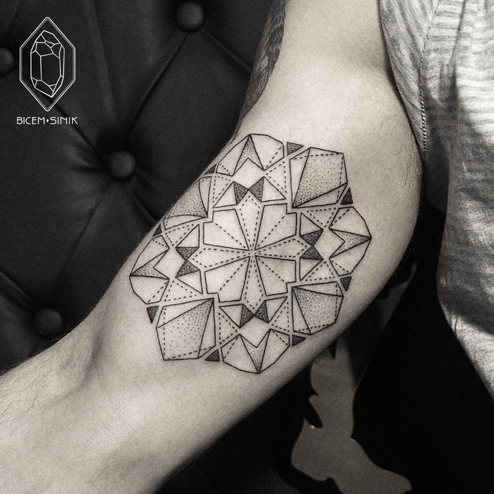 Geometric mandala tattoo on bicep by Bicem Sinik