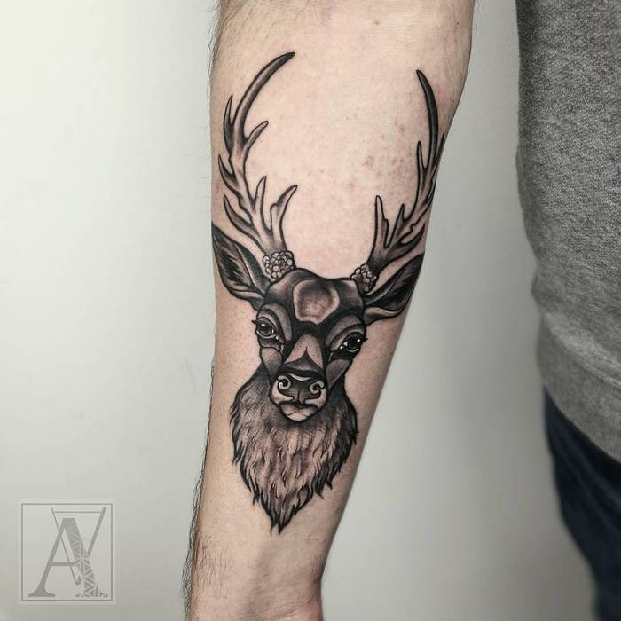 Tradition Black Deer Tattoo on Forearm by Alicja Andersen