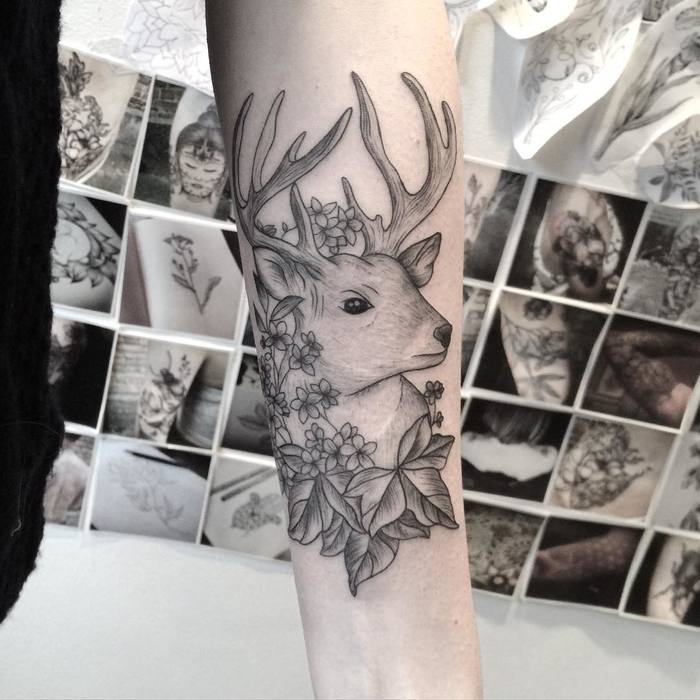 Deer tattoo with forget-me-nots and ivy leafs by Mary Tereshchenko