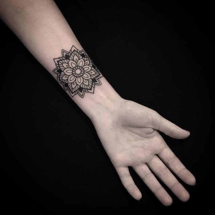 Mandala tattoo on wrist by Luciano LCN
