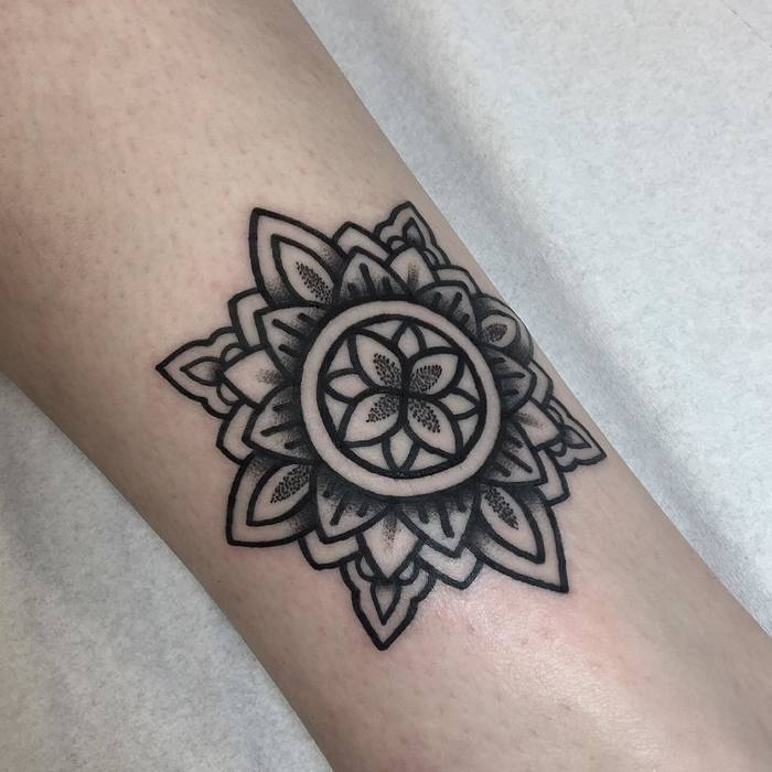 Mandala tattoo by Mark Jelliman