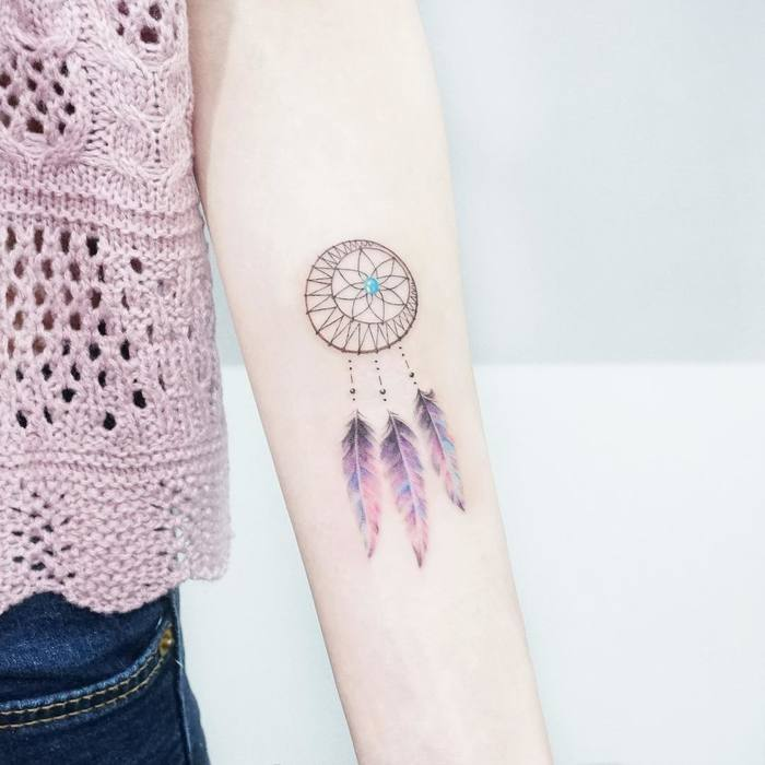 Delicate dreamcatcher tattoo by Tattooist Ida