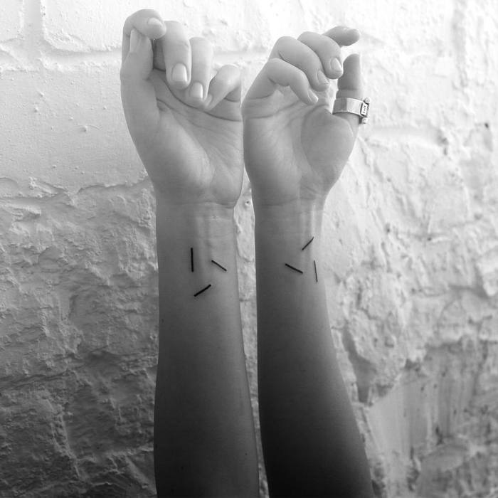 Digimatism: Minimalist Geometric Tattoos Inspired by Digital Technology