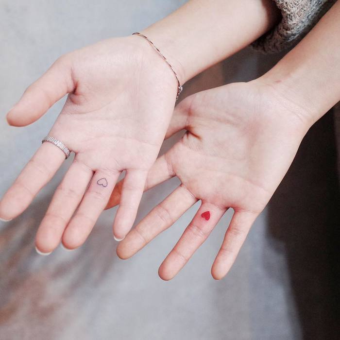 Matching Minimalist Hearts on Fingers by wittybutton_tattoo