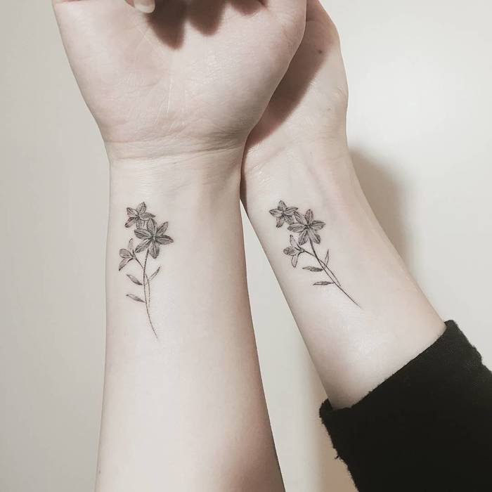 Matching Flowers by tattooist_ty