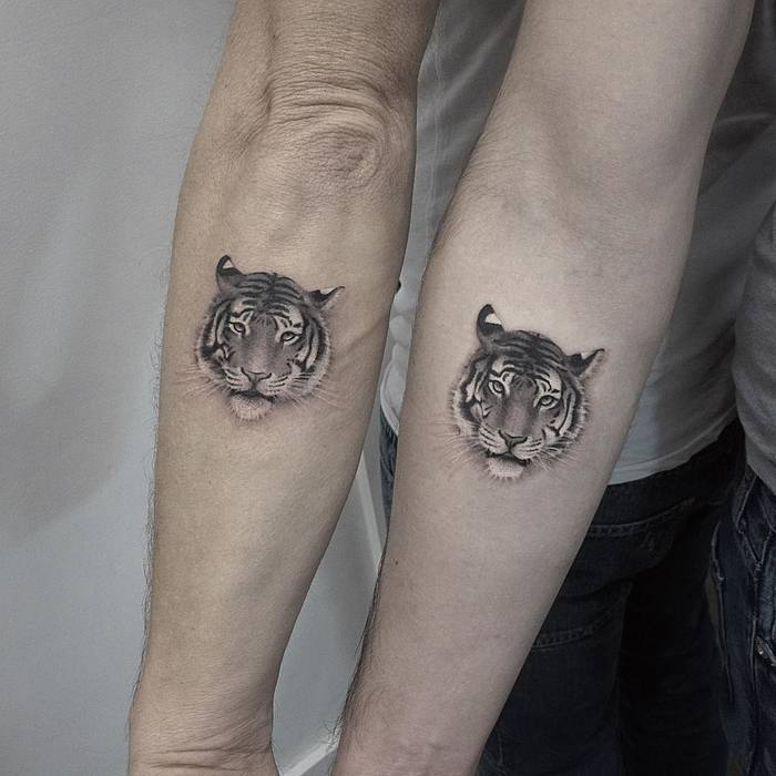 Matching Tiger Tattoos by Elisabeth Markov