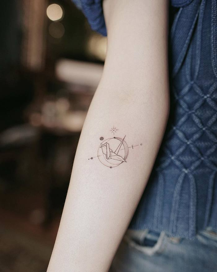 Tiny Paper Crane Tattoo by Nando Tattoo
