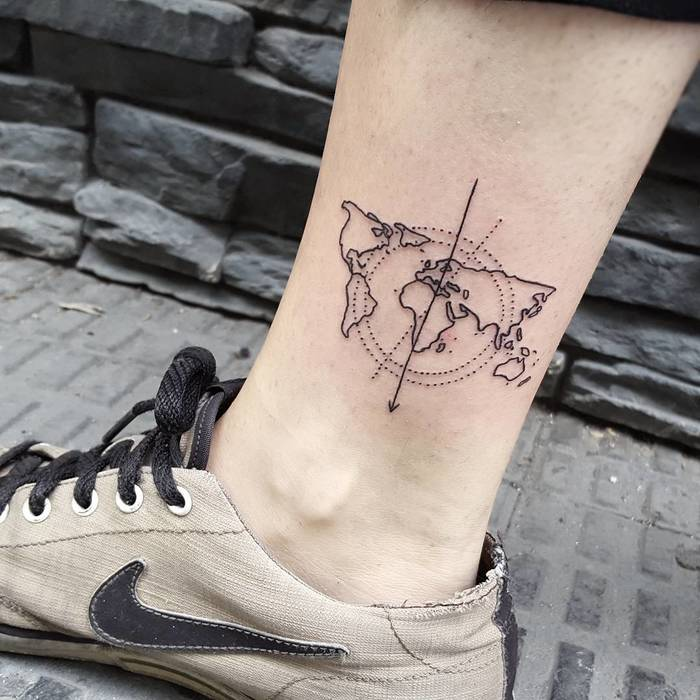 35 best world map tattoo ideas for travel lovers tattoobloq minimalist world map tattoo by isaarttattoo gumiabroncs Choice Image