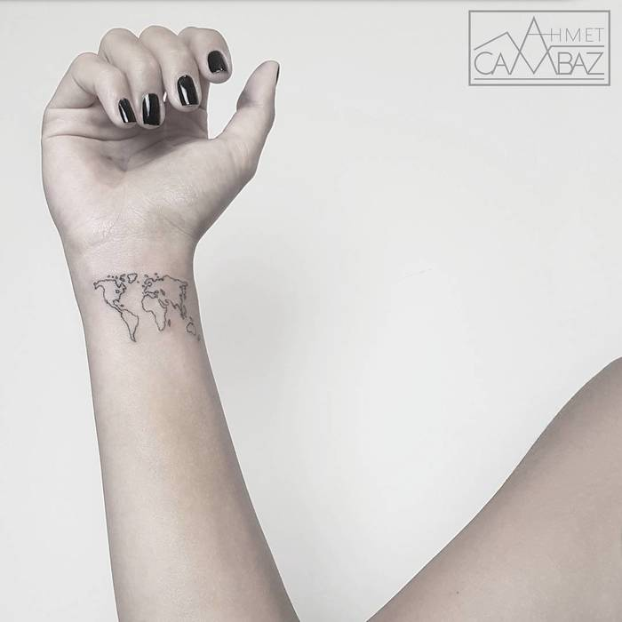 35 best world map tattoo ideas for travel lovers page 2 of 3 22 minimalist world map tattoo on wrist gumiabroncs Image collections