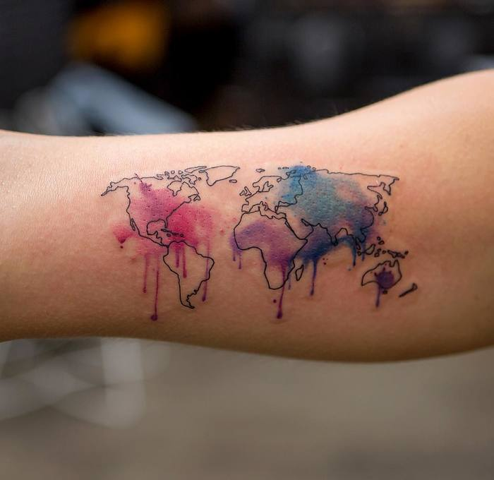 35 best world map tattoo ideas for travel lovers page 3 of 3 25 world map tattoo with watercolor splashes gumiabroncs Gallery