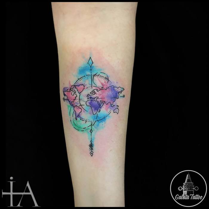35 best world map tattoo ideas for travel lovers page 3 of 3 31 watercolor map with compass on forearm watercolor map tattoo gumiabroncs Images