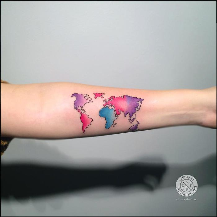 35 best world map tattoo ideas for travel lovers page 3 of 3 32 colored world map tattoo on inner forearm gumiabroncs Images