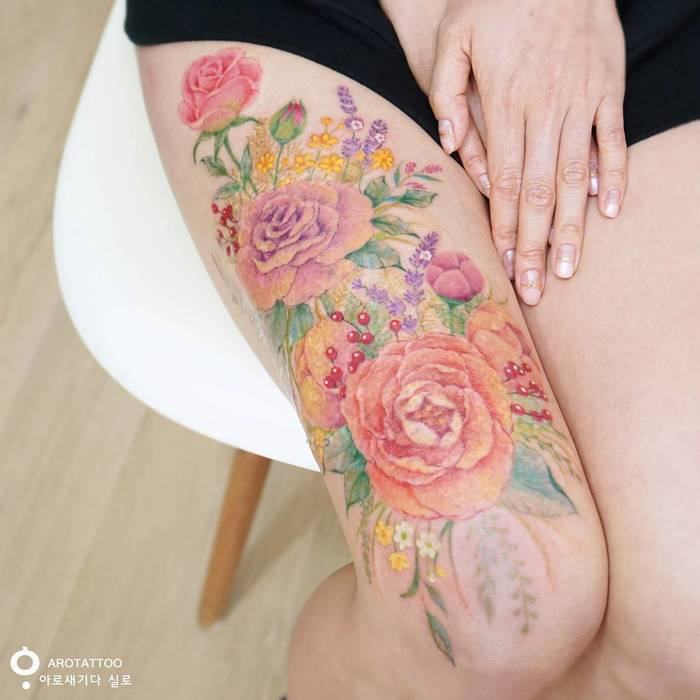 Vibrant Floral Tattoo by Tattooist Silo