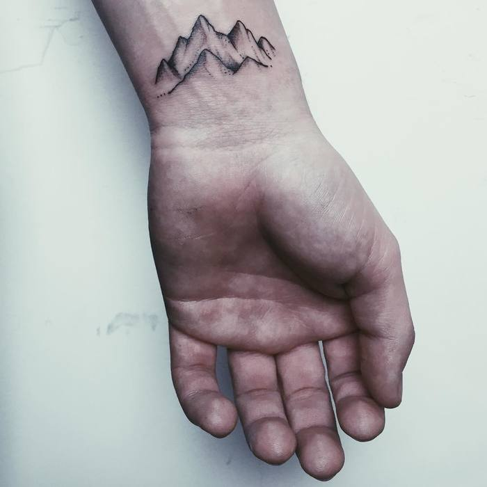 Small Mountain Tattoo on Wrist by Anna Maria Reh