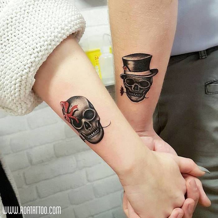 Matching Skull Tattoos by Roa Tattoo