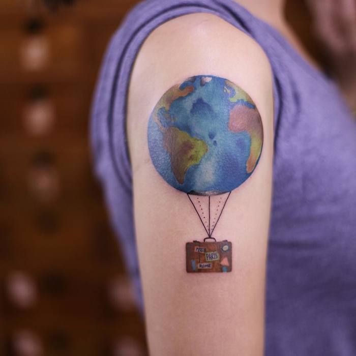 Colored Earth Tattoo on Arm by newtattoo_qiqi