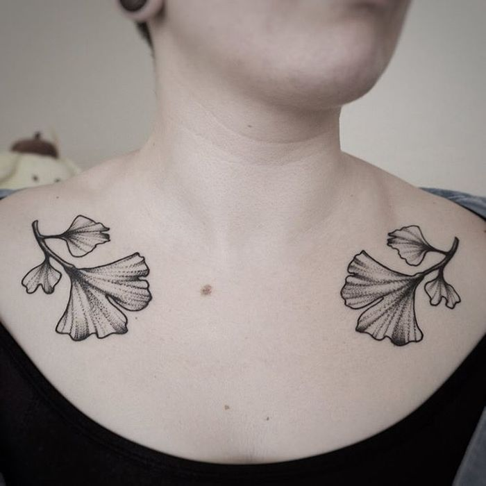 Symmetrical Ginkgo Leaves on Collarbones by clarisseamourtattoo