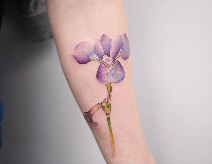 48651282b This violet flower tattoo is delightful. It's a perfect design for someone  who's looking for a delicate but colored tattoo. Picture yourself with this  ...