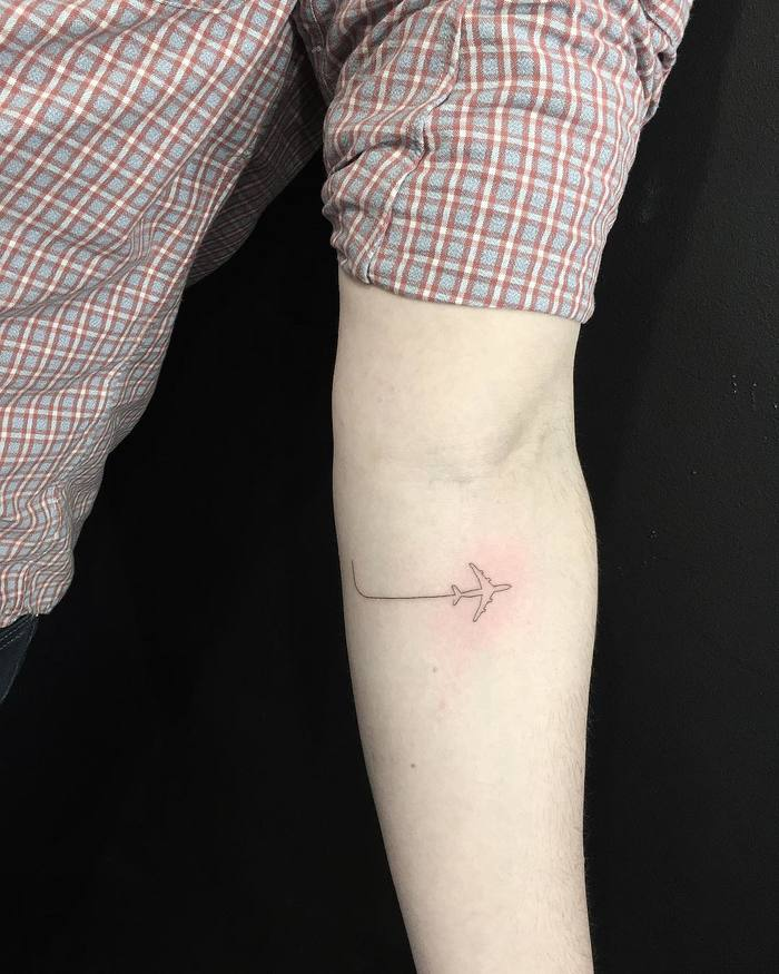 Minimalist Airplane Tattoo by mnsantanatattoo