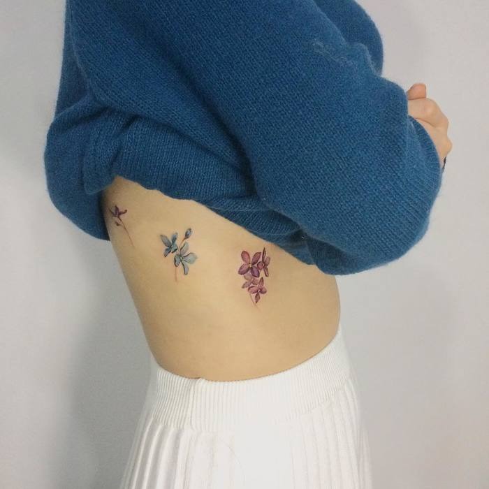 Lilac Flowers on Ribs by tattooist_doy