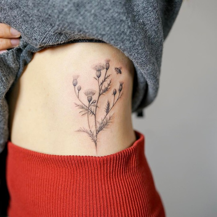 Delicate Thistle Tattoo by nandotattooer