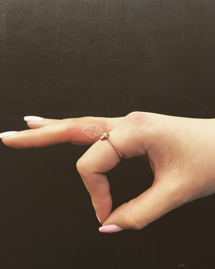 Tiny White Ink Cloud Tattoo on Finger by wickynicky
